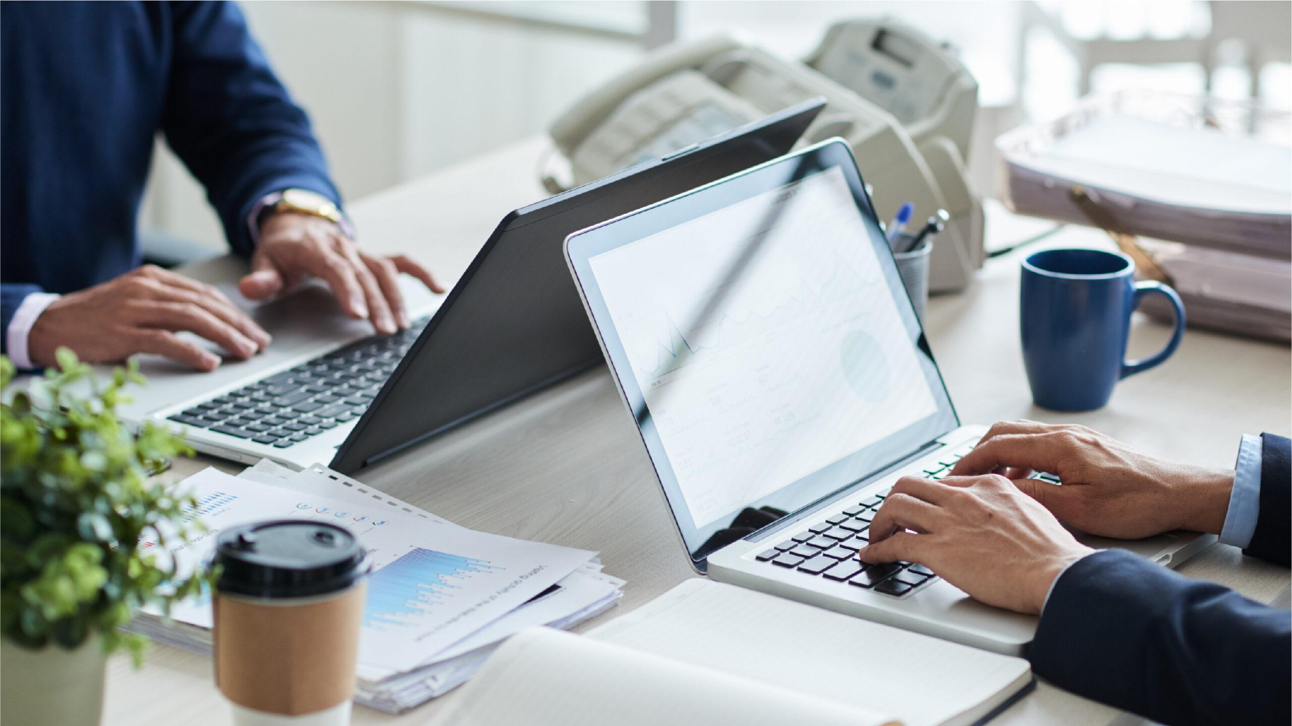 Team working on laptops
